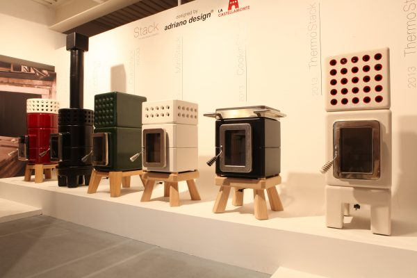 display stand featuring designer ceramic Italian wood burning stoves by Stack Stoves.