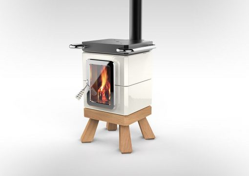 A white cookin stack wood burning stove with wood feet and shiny white finish