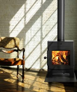A traditional Log Burner on a wooden floor with a wooden chair accent