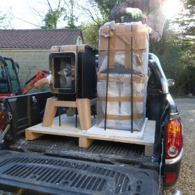 stack stoves on the back of a pick up ready to be installed