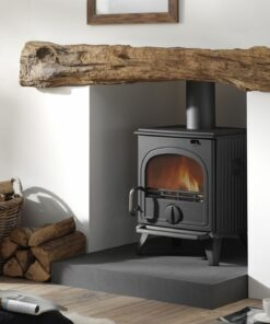 Black Cast Iron Stove in fireplace with oak beam