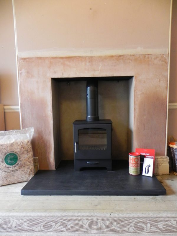 Wood Burning Stove, Fireplace recess and hearth